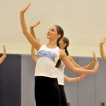 Freshman Ellie Stratman poses as the JV drill team jazz dance begins. Photo by Maddie Smiley