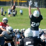 Junior Andy Maddox makes a pass and junior Joesph Mohr blocks the pass. Photo by Izzy Zanone