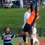 Freshman Will Lowry jumps up to steal the ball from the opposing team. Photo by Izzy Zanone
