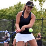 Freshman Quinci Cartmell hits a two-handed backhand across the court during her doubles match. Photo by Audrey Kesler