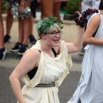 Sophomore Lotus West yells to the crowd as she walks with Latin Club. Photo by Hadley Hyatt