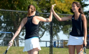 Senior Caro Bush and junior Lidia Ragland high five after a successful match. Photo by Luke Hoffman