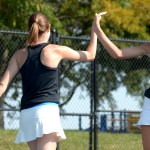 Senior Caro Bush and junior Lidia Ragland high five after a successful match. Photo by Luke Hoffman