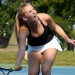 Sophomore Anna Stechschulte reacts to her effort in returning the ball. Photo by Luke Hoffman
