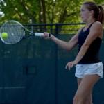 Senior Toni Englund returns the ball in her singles match. Photo by Luke Hoffman