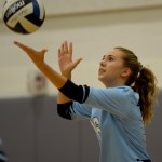 __ __ serves the ball to the Lancers' opponents, the Eagles. Photo by Luke Hoffman