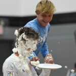 Senior Sam Thompson shoves a plate of whipped cream in sophomore Tj Libeer's face. Photo by Ellen Swanson