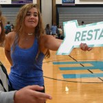 Junior Riley Kimmel signals sophomore Reily Moreland to the Restart Share Project to sign up. Photo by Katherine Odell