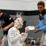 Senior Collyn Lowry and junior Will Tulp throw help each other throw pies at sophomore TJ Libeer. Photo by Katherine Odell