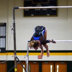 Sophomore Abby Gorman does a flyaway for her dismount off the uneven bars. Photo by Aislinn Menke