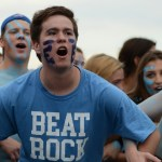 Senior Frank Schudy sways with his friends to get excited before the game. Photo by Reilly Moreland