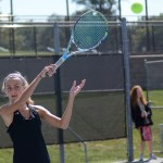 Freshman Allison Wilcox returns a serve in the middle of her doubles match. Photo by Ty Browning