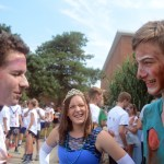 Sophomores Miles Patterson, Hattie Harden and Palmer Bowles make sure their face paint was good. Photo by Ty Browning