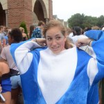 Junior Emma Broaddus adjusts her shark costume.  Photo by Ty Browning