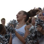 Sophomore Pacey Salzman cheers alongside her fellow varsity lancer dancers before the game begins. Photo by Ty Browning
