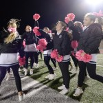 After the Lancer win, cheerleaders celebrate on the sidelines before joining the football players on the field to chant the winning score: 42-28.