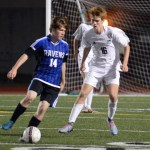 Junior Connor O'Toole guards an ONW player as he approaches the goal. Photo by Ally Griffith
