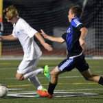 Senior Sam Thompson evades an ONW player as he dribbles the ball away from the goal. Photo by Ally Griffith
