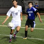 Senior Sam Ragland runs toward the ball to gain control before the opposing player. Photo by Audrey Kesler