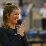 Junior Mallory Frank claps and laughs when the seniors walk out with their parents. Photo by Luke Hoffman