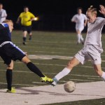 Senior Bennett Meeds steals the ball from the opponent. Photo by Izzy Zanone