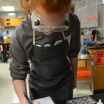 Sophomore Lucy Brock records the results of her experiment. Photo by Kathleen Deedy