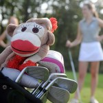 """Junior Caroline Moore has a sock monkey cover for one of her clubs and it has become the team mascot. """"I got the monkey two years ago when I got the clubs. [Junior] Emily Fey named it Emily after herself. I have had it for all the tournaments.""""  Photo by Izzy Zanone"""