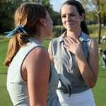 Junior Caroline Moore cries after senior Allison Benson plays her last hole as a member of the golf team. Photo by Izzy Zanone