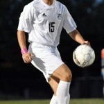 Senior Alex True kicks the ball up after it is passed to him. photo by Ellen Swanson