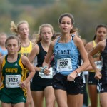 Junior Lucy Hoffman leads a pack of runners in the first half of the five kilometer race. Photo by Luke Hoffman
