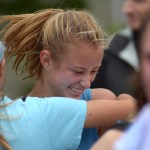 Junior Hazel Eastlack laughs with her teammates after her race. Photo by Luke Hoffman