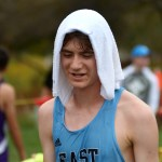 Junior Griffin Keeter cools down after his race with a cold towel provided to the runners by the SME XC Boosters. Keeter qualifies for his third state meet. Photo by Luke Hoffman