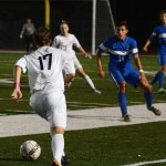 Senior Kristian Jespersen dribbles the ball down the field with his teammate expecting the pass. Photo by Ty Browning