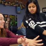 Junior Anika Radadiya teaches junior teaches junior Emma Vossler the wrist movement. Photo by Ally Griffith