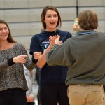 Sophomores Anna Parker and Brigid Went cheer on their teammate during the can relay. Photo by Ally Griffith