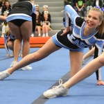 Senior Ava Meng poses during the dance section of the cheer routine. Photo by Ellen Swanson
