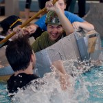 After everyone had raced, several students jump into the pool and playfully try to sink senior Zach Krause's boat along with other students'. Photo by Grace Goldman