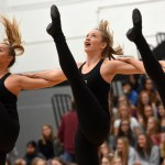 Senior Catherine Watkins sophomore Lauren Decker and Junior Megan Walstrom kick during their 'Can Can' performance during the can drive assembly. Photo by Katherine Odell