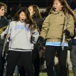 """Sophomores Olivia Hughes and Shelby Winter dance during the band's performance of """"Land of 1000 Dances"""". Photo by Kate Nixon"""