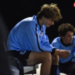 Looking up to watch the game, junior Charley Colby cries on the sideline. Photo by Lucy Morantz