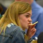 Sophomore and JV team manager Maggie Schutt enjoys dinner while listening to her friends. Photo by Luke Hoffman