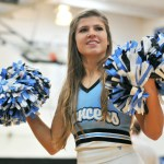 Junior Maggie Gray performs with the varsity cheerleaders while students begin to arrive. Photo by Maddie Smiley
