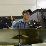 Senior Oliver Nichols plays the drums during the game. Photo by Reilly Moreland