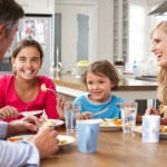 Family Having Meal In Kitchen Together