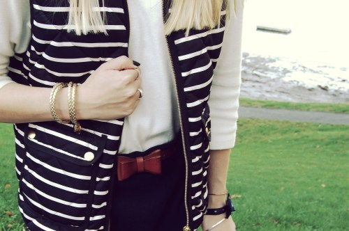 leather bow belt; striped puffy vest
