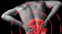 Acute pain in a male lower back, monochrome  image, pain area of red color