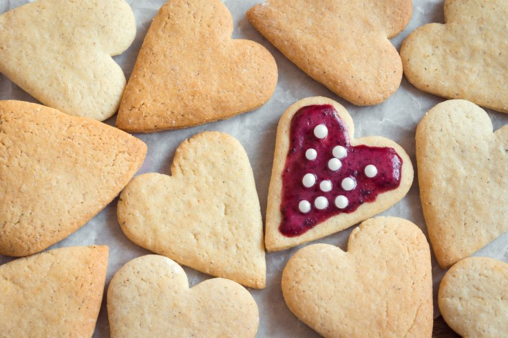Glazed heart shaped cookies for Valentine's day - delicious homemade natural organic pastry, baking with love for Valentine's day