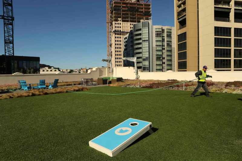 A worker tends to the lawn on the roof of Twitter headquarters in San Francisco, California October 4, 2013. Twitter Inc, racing toward the largest Silicon Valley IPO since Facebook Inc's 2012 coming-out party, hopes to woo investors with rip-roaring revenue growth despite having posted big losses over the past three years. The eight-year-old online messaging service gave potential investors their first glance at its financials on Thursday when it publicly filed its IPO documents, setting the stage for one of the most-anticipated debuts in over a year.   REUTERS/Robert Galbraith  (UNITED STATES - Tags: SCIENCE TECHNOLOGY BUSINESS)