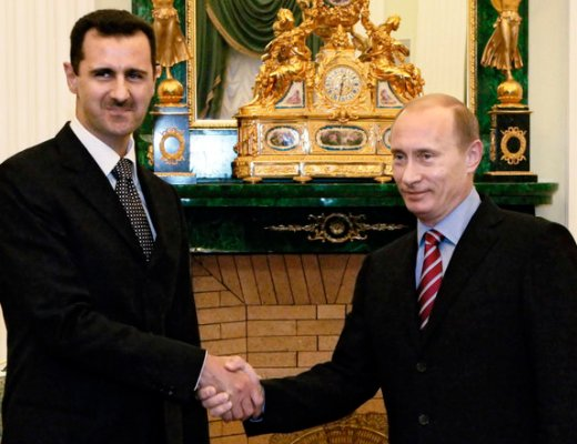 Russian President Vladimir Putin, right, and his Syrian counterpart Bashar Assad smile as they shake hands in Moscow's Kremlin, Tuesday, Dec. 19, 2006. Russian President Vladimir Putin on Tuesday hosted his Syrian counterpart Bashar Assad for talks focusing on tensions among the Palestinians, Lebanon's political standoff and the stalled Middle East peacemaking _ part of Moscow's efforts to bolster its role in the region amid escalating crises. (AP Photo/ Mikhail Klementiev, ITAR-TASS, Presidential Press Service )
