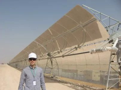 CleanTechnica Director Zachary Shahan (me) at the Shams 1 CSP power plant in Abu Dhabi  not a small CSP power plant. Photo Credit: Marika Krakowiak / CleanTechnica